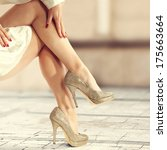legs and gold shoes  | Shutterstock . vector #175663664