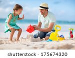 Father And Daughter On Beach...