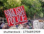 Small photo of Los Angeles - June 6, 2020: Protester holds Abolish Police sign