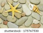 Starfish And Pebbles On The...