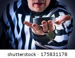 hockey referee hold a puck in... | Shutterstock . vector #175831178