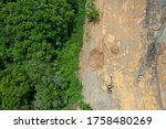 Small photo of Environmental damage. Deforestation and logging. Aerial photo of forest cut down causing climate change