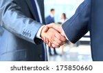 two businessman shaking hands | Shutterstock . vector #175850660