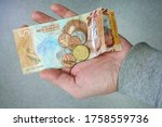 male hand holding new zealand 5 ... | Shutterstock . vector #1758559736