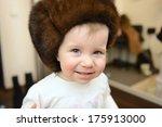 smiling girl in brown fur cap | Shutterstock . vector #175913000