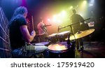 Performances of the musicians, the drummer in the foreground - stock photo