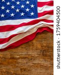 Usa  Flag On Wooden Table...