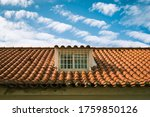 Roof and blue sky with clouds - stock photo