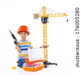Little Builder. Boy In A Helme...