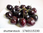 Large Dark Red Cherries On A...