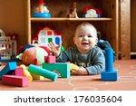 a baby boy plays on the floor...   Shutterstock . vector #176035604