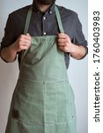 A Man In A Kitchen Apron. Chef...