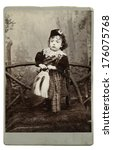 Small photo of High resolution scan of a genuine vintage photograph circa 1893-1900 of young boy in traditional Scottish costume with kilt, horse-hair sporran and bonnet.
