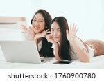 Two Young Asian Women Spending...