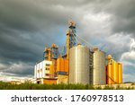 Modern Silo. Set of storage tanks cultivated agricultural crops processing plant.  - stock photo