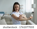 Woman Sit On Sofa In Living...