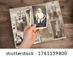Old Man Holds His Old Photos...