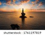 A Lighthouse On A Steep Rock...