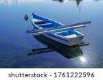 A Small Blue White Boat At Sea