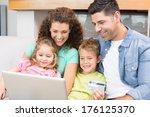 happy family sitting on sofa... | Shutterstock . vector #176125370