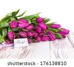 purple tulips with card on wood ...   Shutterstock . vector #176138810