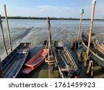 Small Fishing Boat Low Tide At...
