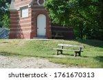 A Chair Next To A Church In A...