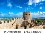 Ancient fortress tower on blue sky clouds