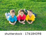 group of smiling kids lying on... | Shutterstock . vector #176184398