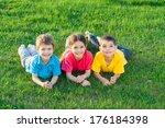 group of smiling kids lying on... | Shutterstock . vector #176184398
