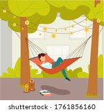 Man Lying In A Hammock And...