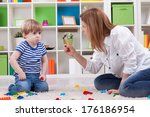 angry mother scolding a... | Shutterstock . vector #176186954