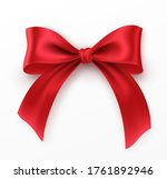 Red Bow And Ribbon On White...