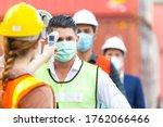 Female Worker Scanning Fever...