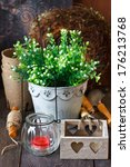 Rustic gardening tools and candle on the old wooden board in the garden. - stock photo