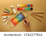 A Child's Hand Paints A...
