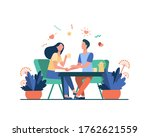 young couple sitting in...   Shutterstock .eps vector #1762621559