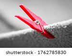 Red Clothes Peg Holding Washed...