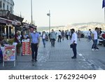 Small photo of Istanbul / Turkey June 20, 2020 on the beach masked and unmasked people browsing the streets