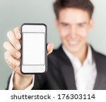 man showing smart phone mobile | Shutterstock . vector #176303114