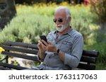 Old Man Browsing App On...