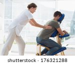 side view of man receiving back ... | Shutterstock . vector #176321288