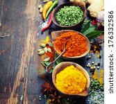 spices and herbs over wood.... | Shutterstock . vector #176332586