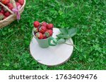 Strawberries In A Green Cup On...