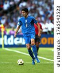 Small photo of Berlin, GERMANY - July 09, 2006: Fabio Grosso in action during the 2006 FIFA World Cup Germany Final Italy v France at the Olympiastadion.
