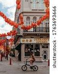 Small photo of London, UK - June 14, 2020; Deserted Chinatown in London, during coronavirus lockdown in daytime. Gerrard Corner with hanging Chinese red lantern.