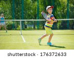 little cute boy playing tennis... | Shutterstock . vector #176372633