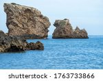 Big Rocks In The Blue Sea With...