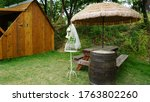 Parasols And Tables With Wood...