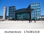 BERLIN, GERMANY - APRIL 19: main station with unidentified people on April 19, 2012 in Berlin. It's the largest interchange station in Europe and from number of (300.000) passengers the 4th in Germany - stock photo